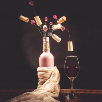Bottle With A Bouquet Of Corks And Flowers