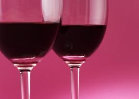 Two_wine_glasses_pink_background.jpg