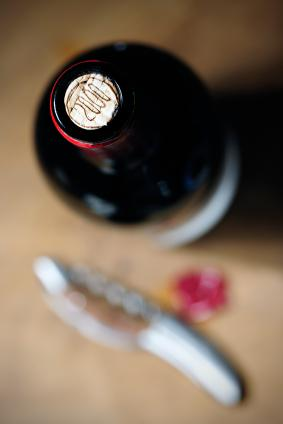 Red wine bottle with foil removed