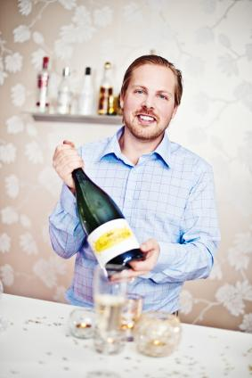 man holding large champagne bottle