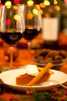 Pumpkin pie and two glasses of red wine