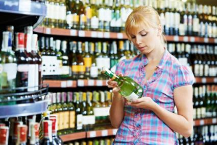 Woman shopping for sparkling wine