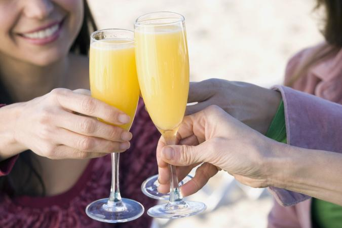 toasting with mimosas