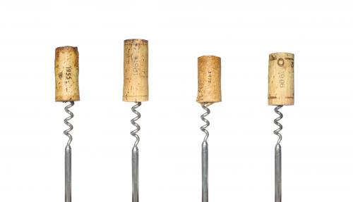 Vintage wine corks on corkscrews