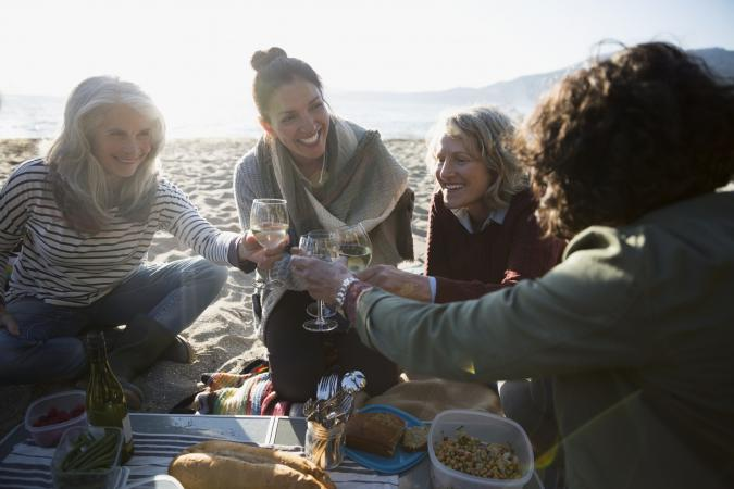 Drinking wine at a beach picnic