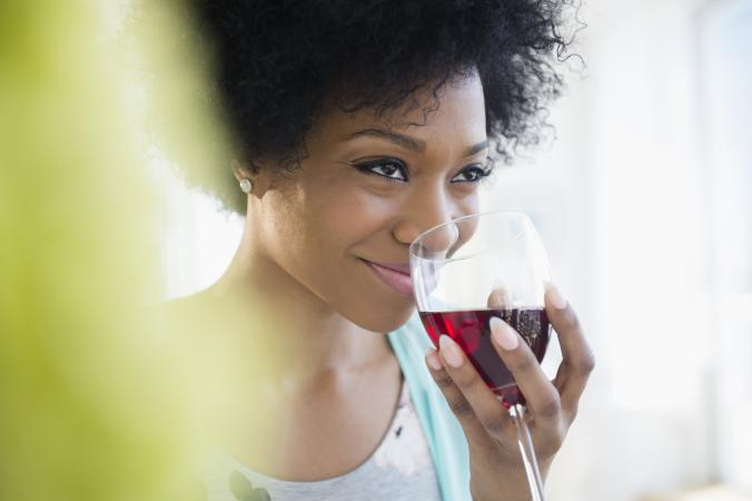 woman sniffing red wine