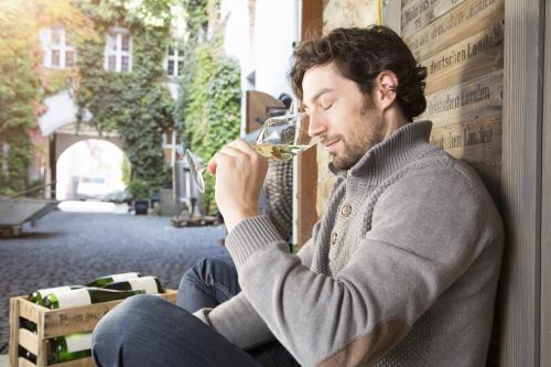 Man sniffing white wine