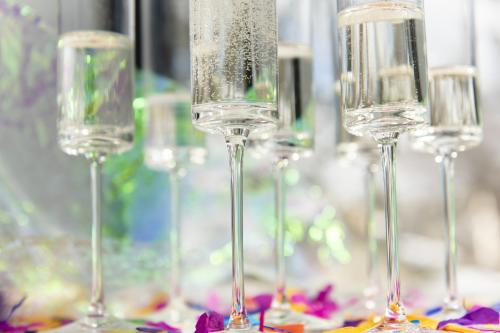 Champagne flutes and confetti