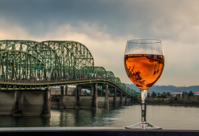 Glass of wine and the I5 Portland bridge
