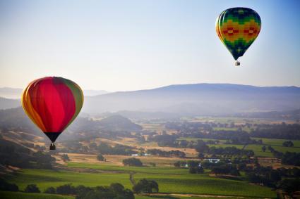 Hot air balloons over green landscape, Napa Valley, California