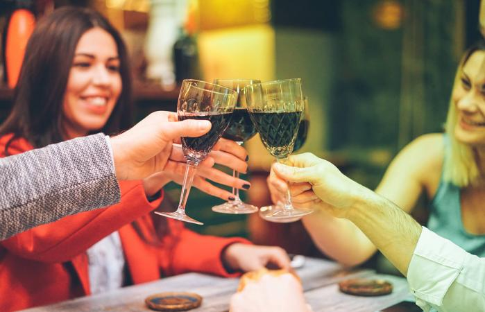 Friends raising toast with wine
