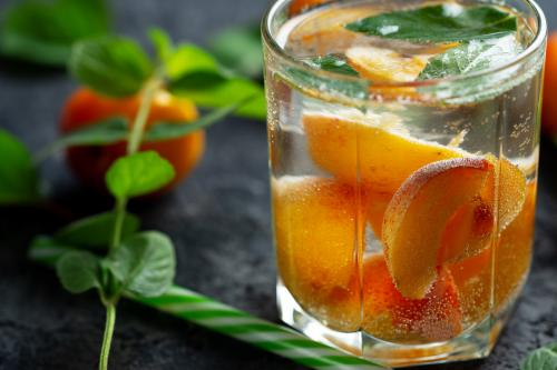 Glass of apricot sangria