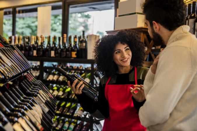woman selling wine to a customer