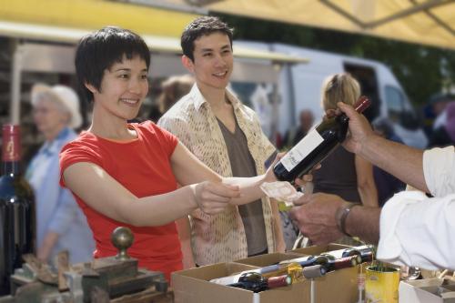 Wine merchant recommending a bottle of Merlot