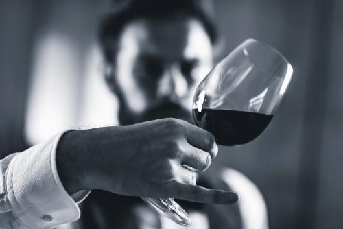 Wine critic evaluating Merlot