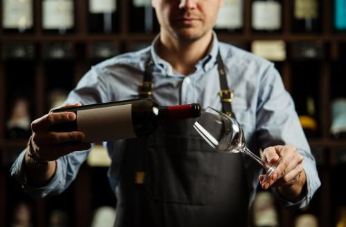 Server pouring wine