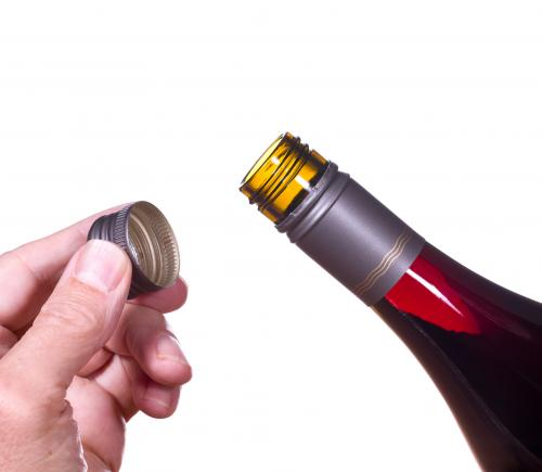 Removing a wine bottle screw cap