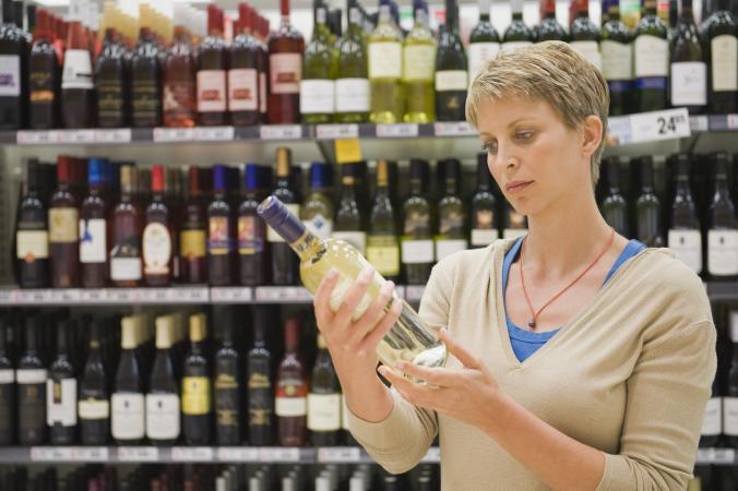 Woman holding bottle of wine