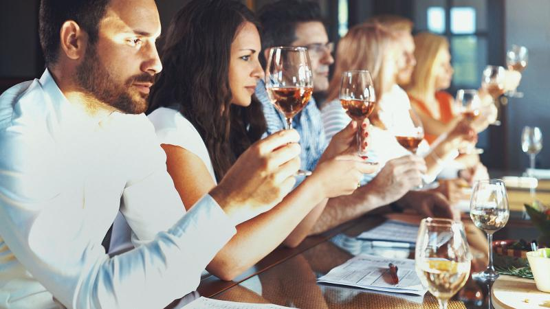 group tasting different types of wine at a winery