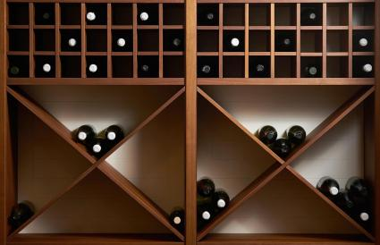 Bottles of wine on a wooden shelf