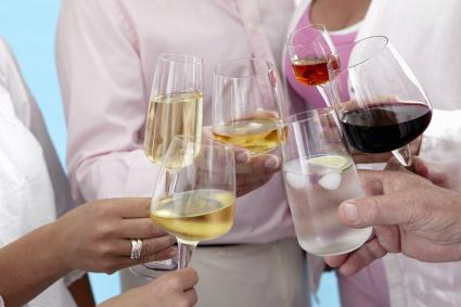 People raising wine glasses in a toast