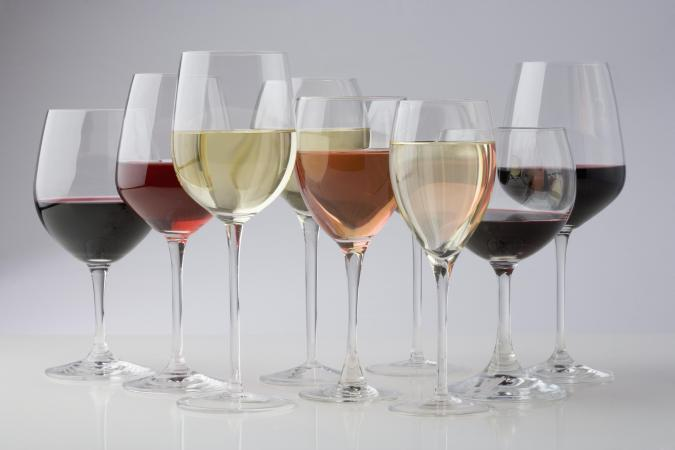 Group of wine goblets filled with different wines