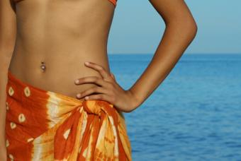 Young woman wearing a sarong swimsuit coverup