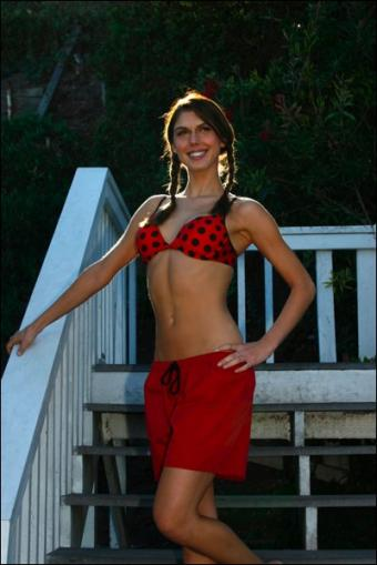 Young woman in red Trunkettes and a bikini top