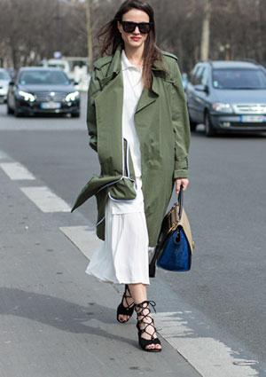 Woman wearing green Burberry trench coat