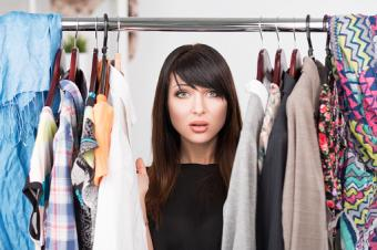 confused woman with clothes