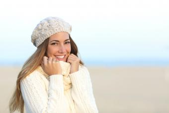 Woman wearing white sweater at the beach