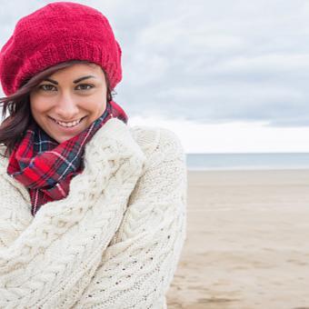 Woman wearing a winter white sweater