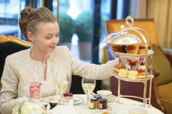 Classy woman enjoying high tea