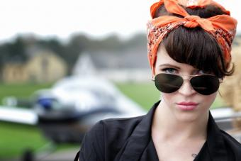 Woman In Double-Wire Aviator Sunglasses