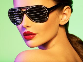 Woman wearing jeweled sunglasses
