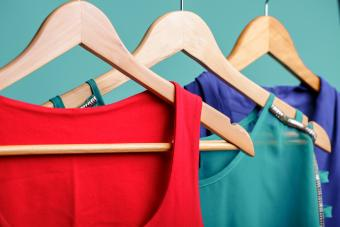 Colorful women`s shirts on hangers