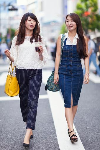 Two young Japanese women are walking