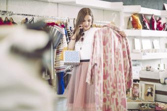 Woman considering buying fashionable pink jacket