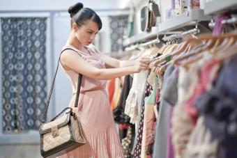 lady browsing clothes in dress shop