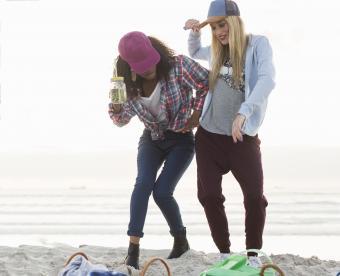 Sporty women, dancing in the beach