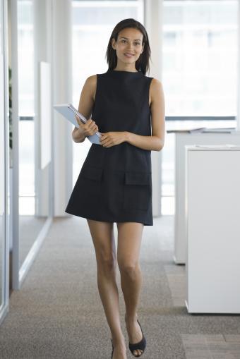 Woman in preppy black shift dress