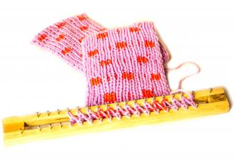 Pink loom knitting in progress