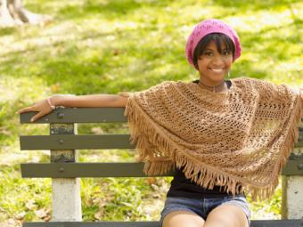Woman wearing cap and poncho