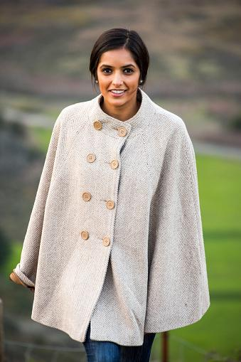 Indian woman wearing classy poncho
