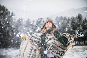 Woman with fur hat and poncho