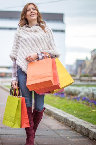 Shopper wearing fur poncho