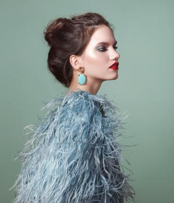 Beautiful woman wearing feather dress