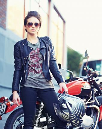 Young and stylish motorcycle rider