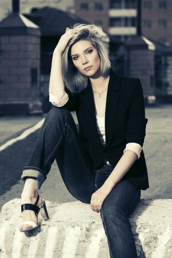 Dark, tailored jeans on attractive woman