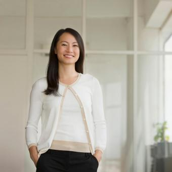 Asian woman in conservative sweater